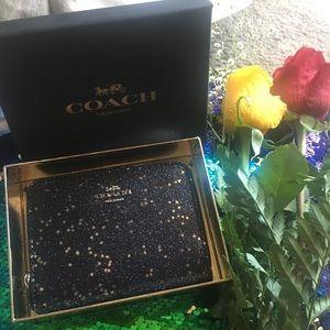 $175 NWT Coach black star glitter zip
